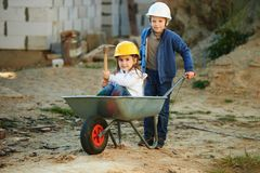 Boy and girl playing on construction site Royalty Free Stock Photo