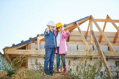 Boy and girl playing on construction site Stock Photo