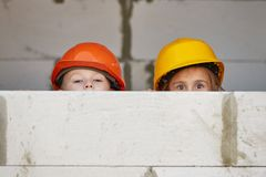 Boy and girl playing on construction site Royalty Free Stock Image