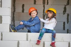 Boy and girl playing on construction site Stock Image