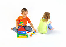 Boy and girl playing with a constructor