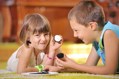 Boy  and girl playing with cookies Stock Images
