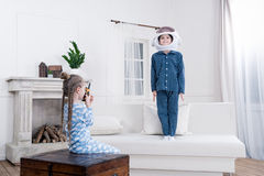 Boy and girl playing cosmonauts at home Stock Photography