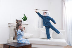 Boy and girl playing cosmonauts together Stock Images
