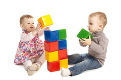 Boy and girl playing with cubes Stock Photos
