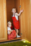 Boy with girl playing hide and seek Stock Images