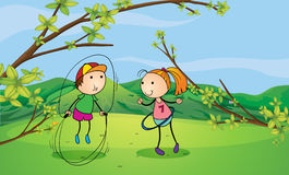 A boy and a girl playing in the hills Stock Photography