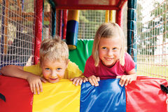 Boy and girl playing in the maze Royalty Free Stock Photo