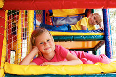 Boy and girl playing in the maze Stock Photography