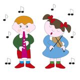 Boy and girl playing a melody on a musical instrument. Children boy and girl playing a melody on a musical instrument Royalty Free Stock Photography