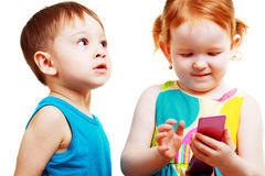 Boy and girl playing with mobile Stock Image