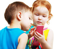 Boy and girl playing with mobile Stock Photo