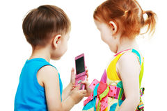Boy and girl playing with mobile Stock Images