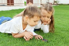 Boy and girl playing on a mobile phone Stock Image