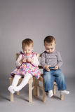 Boy and girl playing with mobile phones Royalty Free Stock Photos