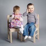 Boy and girl playing with mobile phones Stock Image