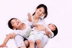 Boy and girl playing with mother. Picture of a little chinese boy and girl playing with mother happily on the floor Royalty Free Stock Photo