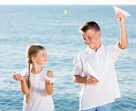 Boy and girl playing origami planes Royalty Free Stock Images