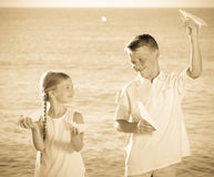 Boy and girl playing origami planes Stock Photos