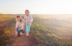 Boy and girl playing outdoors Royalty Free Stock Photos