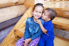 Boy and girl playing outdoors Stock Photo