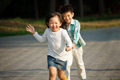 Boy and girl playing outdoors Stock Photography