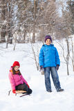 Boy and girl playing outside on snow. Royalty Free Stock Image