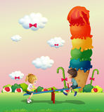 A boy and a girl playing at the park with sweets Stock Image