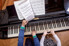 Boy and a girl playing piano Royalty Free Stock Image