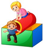 Boy and girl playing in the playground stock illustration