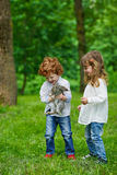Boy and girl playing with rabbit Stock Photos