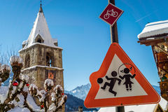 Boy and girl playing on a roadsign Royalty Free Stock Photography
