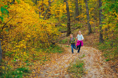 Boy and girl playing run in forest Royalty Free Stock Photo