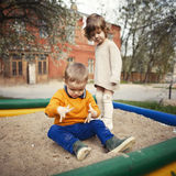 Boy and girl playing in sandbox Royalty Free Stock Photo