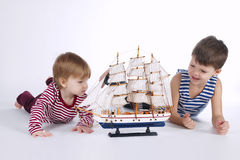 Boy and girl playing with ship Royalty Free Stock Photos