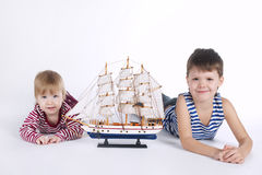 Boy and girl playing with ship Royalty Free Stock Images