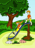 Boy and girl playing slide at the playgrounds Royalty Free Stock Images