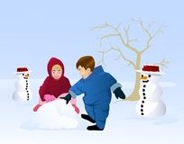 Boy and girl playing snow Royalty Free Stock Image