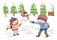 Boy and Girl Playing With Snow. A carefree and  happy young couple having fun together in snow in winter woodland throwing snowballs at each other during a mock Stock Photography