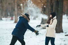 Boy and girl playing with snow Royalty Free Stock Photos