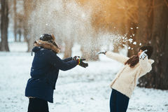 Boy and girl playing with snow Stock Images