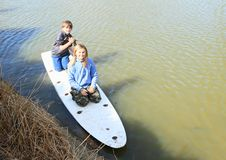 Boy and girl playing on surf royalty free stock photography