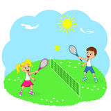 Boy and girl playing tennis Stock Image