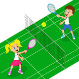 Boy and girl playing tennis Stock Photo