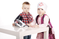 Boy and girl playing with tonometer Stock Image