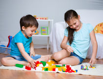 Boy and girl playing with toys Royalty Free Stock Photo