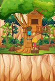 Boy and girl playing at the treehouse Royalty Free Stock Images