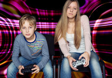 Boy and girl playing video games Royalty Free Stock Photo
