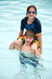 Boy and Girl Playing in the Water. A young boy and girl clowning around in the water. Nine years old royalty free stock images