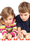 Boy and girl playing with wooden railway Royalty Free Stock Photo
